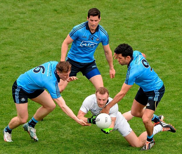 Kildare's Alan Smith tries to escape the attentions of Dublin players (left to right) John Small, Rory O'Carroll, and Cian O'Sullivan DÁIRE BRENNAN/SPORTSFILE