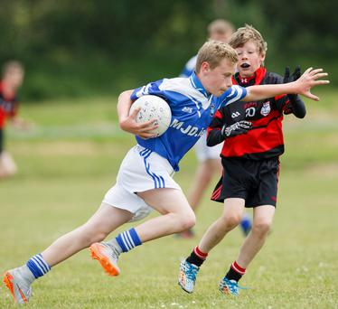 Callum Kelly of St Patrick's Wicklow Town takes on Joe Dundon from Mount Leinster Rangers in Carlow in the Boys Division 3 Shield at the Féile Peil in Ballinakill, Wicklow ALF HARVEY/HR PHOTO