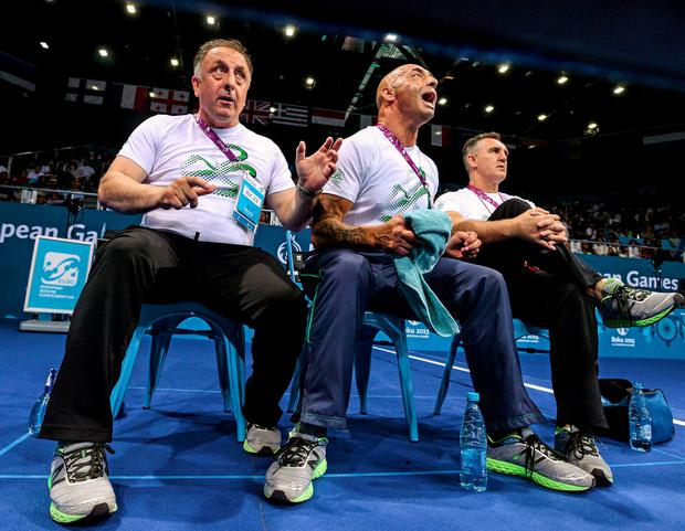 The Irish coaches Zaur Antia, Pete Taylor and Gerry Storey cheer Taylor to victory, before Pete embraces his daughter STEPHEN MCCARTHY/SPORTSFILE