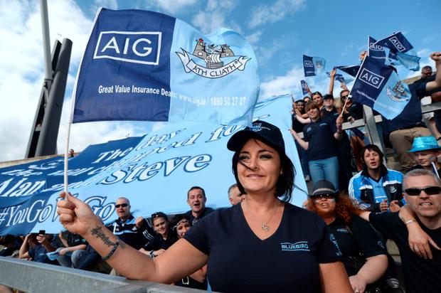 28 Jun 2015; Tracy Harris (widow of Alan Harris) with friends and family of Harris brothers as they pay tribute after the match by raising flags and singing. Leinster Senior Football championship semi-final, Dublin v Kildare. Croke Park, Dublin, Dublin. Picture: Caroline Quinn