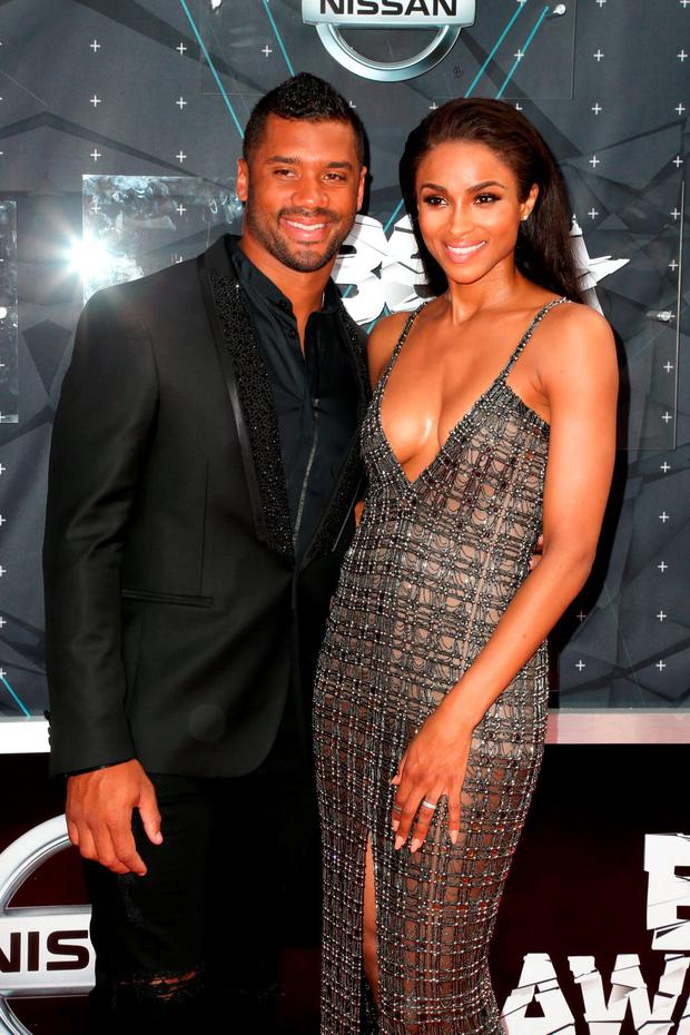 Professional football player Russell Wilson (L) and recording artist Ciara attend the 2015 BET Awards at the Microsoft Theater on June 28, 2015 in Los Angeles, California. (Photo by Frederick M. Brown/Getty Images for BET)