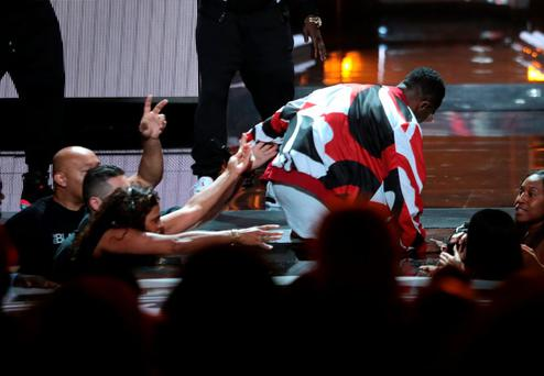 LOS ANGELES, CA - JUNE 28: Recording artist Diddy falls during performance onstage during the 2015 BET Awards at the Microsoft Theater on June 28, 2015 in Los Angeles, California. (Photo by Mark Davis/BET/Getty Images for BET)