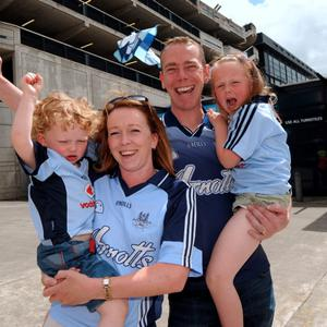 28 Jun 2015; Dublin fans Kevin and Jill Phelan with daughter Grace, 5, and Jack, 3, from Lucan. Leinster Senior Football championship semi-final, Dublin v Kildare. Croke Park, Dublin, Dublin. Picture: Caroline Quinn