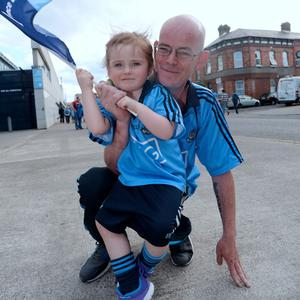 28 Jun 2015; Dublin fans Colm Lyons, from Rush, and daughter Saoirse, 2. Leinster Senior Football championship semi-final, Dublin v Kildare. Croke Park, Dublin, Dublin. Picture: Caroline Quinn