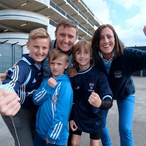 28 Jun 2015; Dublin fans the O'Neills from Finglas; James and Tania with James Junior, 12, Daniel, 10, and Sam, 6. Leinster Senior Football championship semi-final, Dublin v Kildare. Croke Park, Dublin, Dublin. Picture: Caroline Quinn