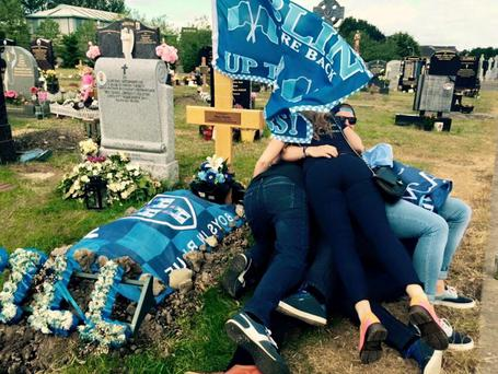 The Harris' family draped Dublin GAA colours over Alan's grave yesterday