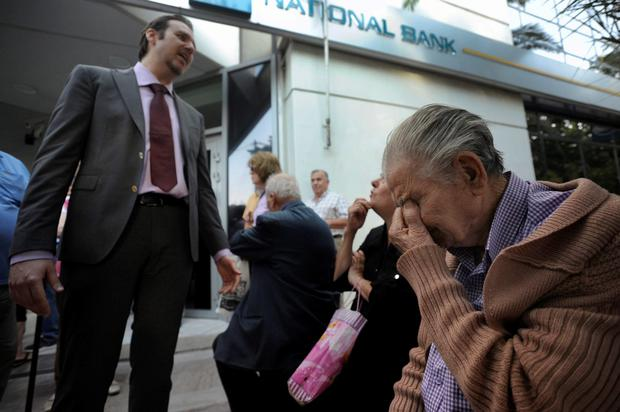 Greece crisis: Greeks in shock, cash machines running out of
