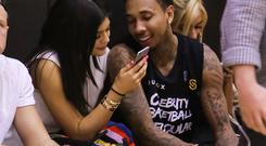 Reality TV Personality Kylie Jenner (L) and Rapper Tyga (R) attend the