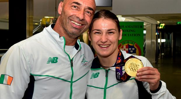 Katie Taylor with her father and coach Pete Taylor on their return from the 2015 Baku European Games