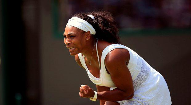 Serena Williams celebrates against Margarita Gasparyan in the the First round women's singles during day one of the Wimbledon Championships at the All England Lawn Tennis and Croquet Club, Wimbledon