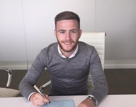 Jack Byrne signing his new deal with Manchester City