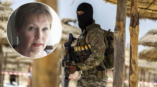 Heavily armed Tunisian soldiers patrol the beaches, inset, Marian King