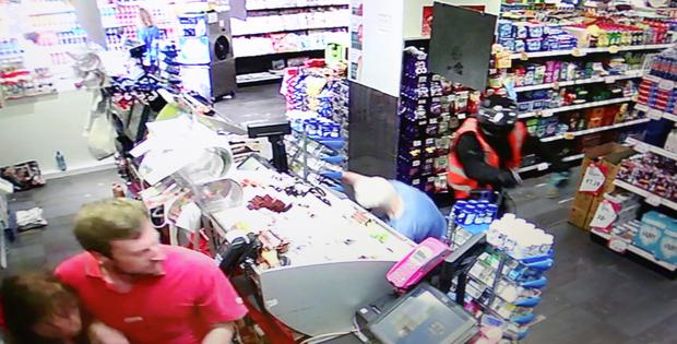 FROM CCTV....The lone raider knocks an elderly Woman over at The Glasnevin Avenue Spar. 3 of series.