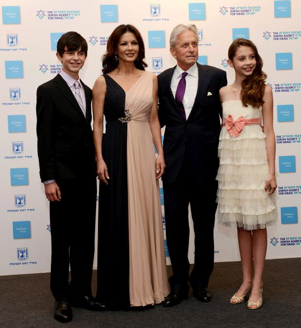 Actor Michael Douglas (2nd R), his wife Catherine Zeta Jones, son Dylan and daughter Carys, pose for a photograph upon their arrival for the Genesis Prize award ceremony in Jerusalem