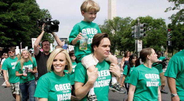 Actors Jenny McCarthy and former partner Jim Carrey, carrying her son Evan, take part in a rally calling to eliminate toxins from children's vaccines in 2008