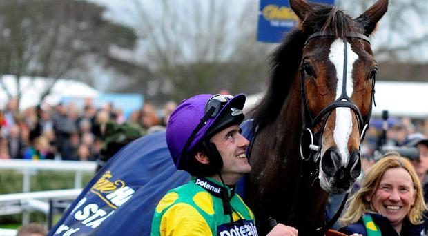Ruby Walsh smiles as he looks at Kauto Star after winning The William Hill King George VI Steeple Chase at Kempton in 2011