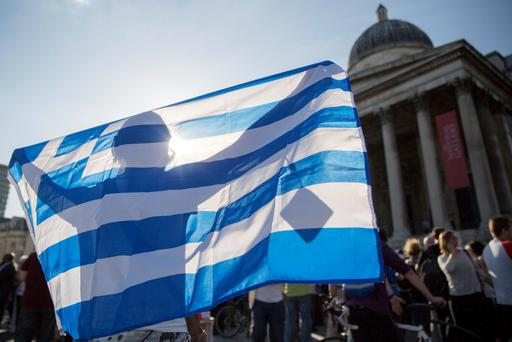 Demonstrators gather to protest against the European Central Bank's handling of Greece's debt repayments Credit: Neil Hall