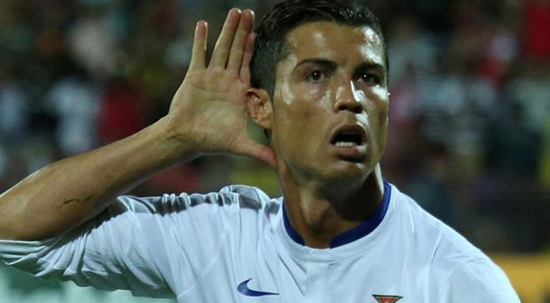 Kiss my face: Ronaldo with his best Hulk Hogan impersonation Photo: AP