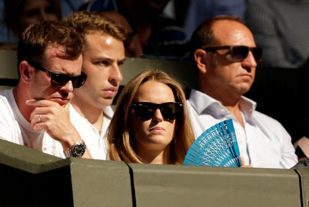 Kim Murray uses a fan as she watches husband, Andy Murray