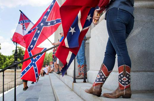 Pro-confederate flag demonstrators wears confederate flag cowboy boots as she protests atop the South Carolina State House steps in Columbia, South Carolina