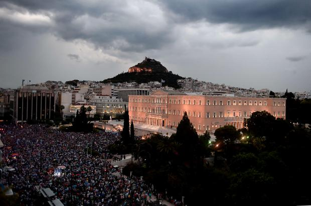 Pro-European Union protester demonstrate in front of the parliament in Athens