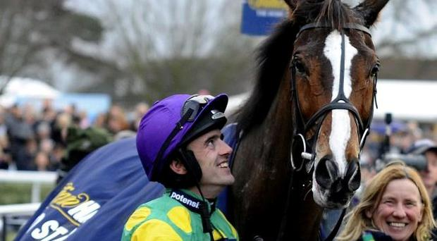 Ruby Walsh with Kauto Star after his record-breaking fifth victory in the King George Chase