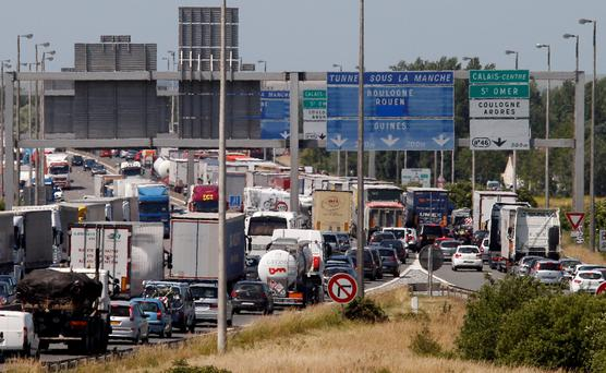 Cars and trucks are stuck in a traffic jam on a highway leading to the Channel tunnel after striking workers invaded the Eurotunnel train tracks in Calais, northern France, in a protest against job cuts. Photo: AP