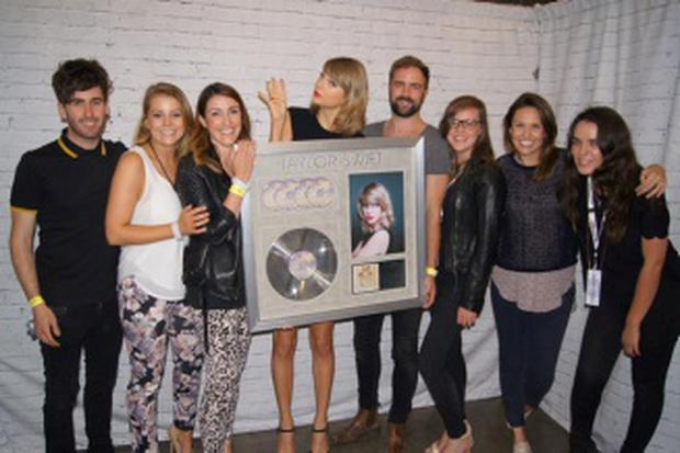 Taylor Swift being presented with a plaque to mark her sales in Ireland