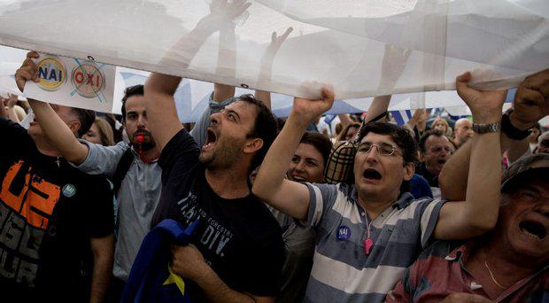 Pro-Euro protestors shout slogans during a rally in front of the parliament building, in Athens, Greece, June 30, 2015