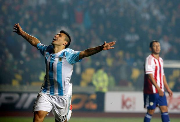 Argentina's Sergio Aguero celebrates after scoring a goal as Paraguay's Ivan Piris looks on during their Copa America 2015 semi-final soccer match at Estadio Municipal Alcaldesa Ester Roa Rebolledo in Concepcion, Chile, June 30, 2015. REUTERS/Andres Stapff