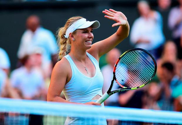 Caroline Wozniacki of Denmark celebrates winning her Ladies Singles first round match against Saisai Zheng of China during day two of the Wimbledon Lawn Tennis Championships at the All England Lawn Tennis and Croquet Club on June 30, 2015 in London, England. (Photo by Shaun Botterill/Getty Images)