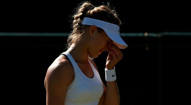 Canada's Eugenie Bouchard in action against China's Ying-Ying Duan at Wimbledon yesterday