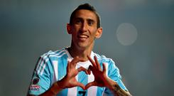 Argentina's forward Angel Di Maria celebrates after scoring against Paraguay last night