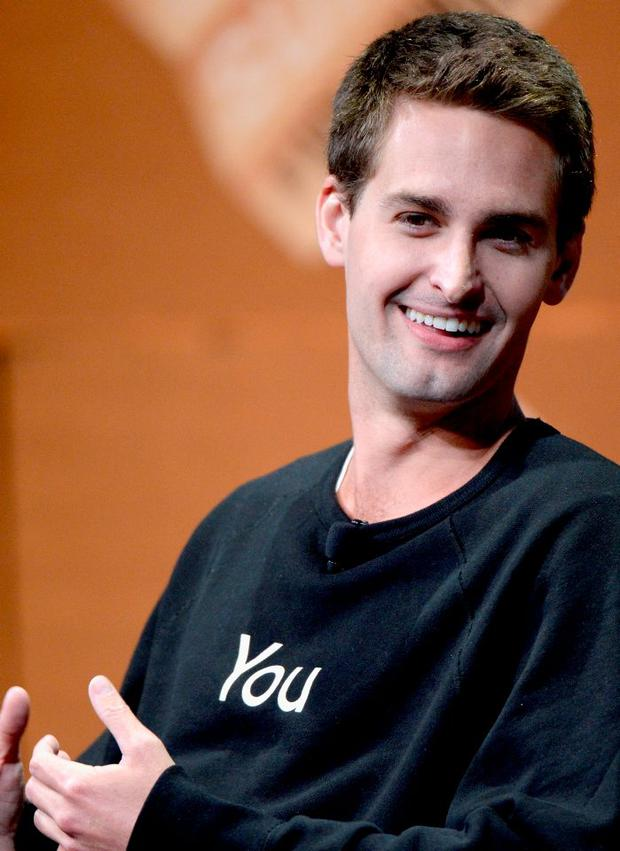 Snapchat CEO Evan Spiegel speaks onstage during