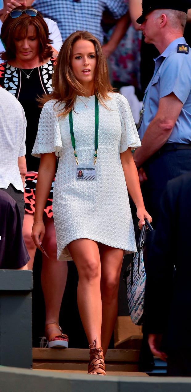 Kim Sears, wife of Britain's Andy Murray arrives at Centre Court to watch her husband play against Kazakhstan's Mikhail Kukushkin during their men's singles first round match on day two of the 2015 Wimbledon Championships