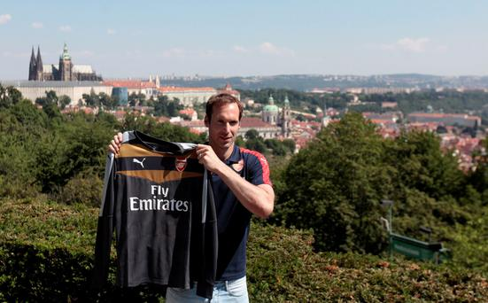 Czech soccer player Petr Cech shows his Arsenal jersey during his presentation in Prague