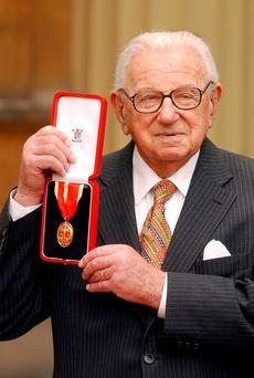 Sir Nicholas Winton, with his Knighthood in the forecourt of Buckingham Palace