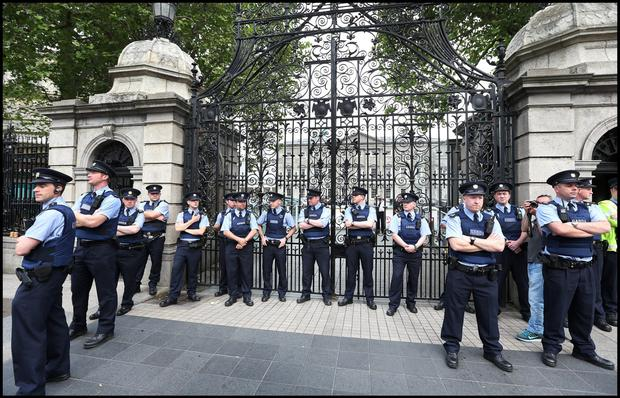 Gardai stand guard at the gates of the Dail closing them during protests. Pic Steve Humphreys 1st July 2015.