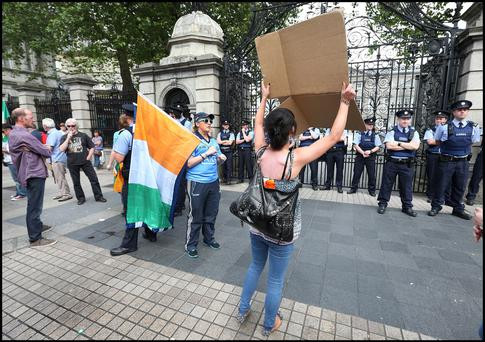 Protesters remonstrating with Gardai out the Dail. Pic Steve Humphreys 1st July 2015.