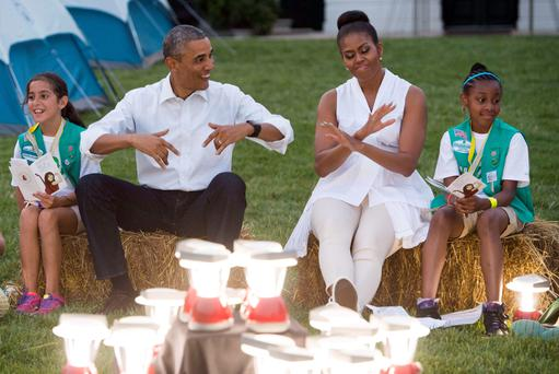 US President Barack Obama and First Lady Michelle Obama visit 50 Girl Scouts camping at the White House. Photo: Getty