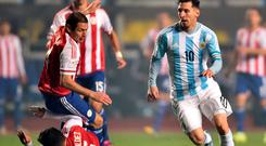 Lionel Messi leaves the Paraguayan defence tackling each other as he skips through during the semi-final victory