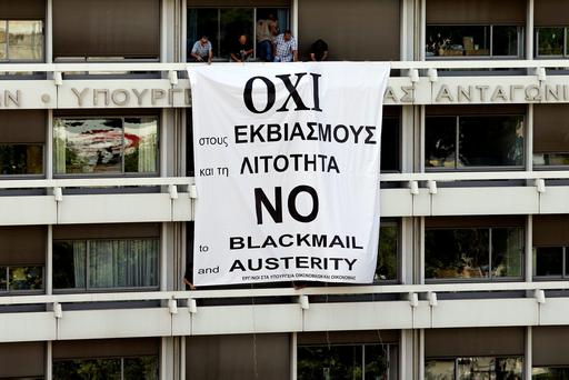 A banner flies from a balcony of the Finance Ministry in Athens, Greece