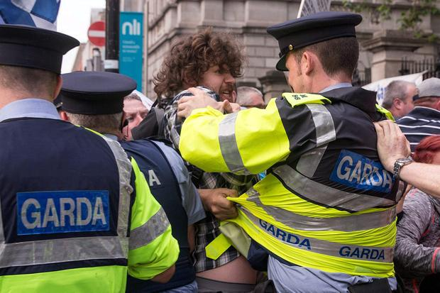An anti-austerity protest outside the Oireachtas descended into chaos yesterday evening. The sit-down protest on Kildare Street caused rush-hour traffic delays. Photo: Arthur Carron