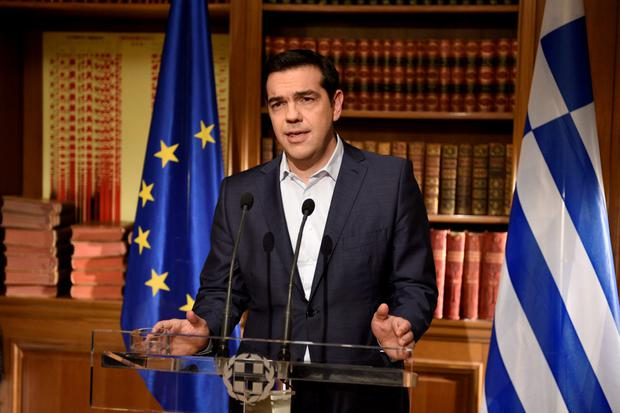 Greek Prime Minister Alexis Tsipras addresses the nation in this handout photo released by the Greek Prime Minister's office in Athens, Greece July 1, 2015. A defiant Tsipras urged Greeks on Wednesday to reject an international bailout deal, wrecking any prospect of repairing broken relations with EU partners before a referendum on Sunday that may decide Greece's future in Europe. REUTERS/Andrea Bonetti/Greek Prime Minister's Office/Handout via Reuters ATTENTION EDITORS - THIS PICTURE WAS PROVIDED BY A THIRD PARTY. REUTERS IS UNABLE TO INDEPENDENTLY VERIFY THE AUTHENTICITY, CONTENT, LOCATION OR DATE OF THIS IMAGE. FOR EDITORIAL USE ONLY. NOT FOR SALE FOR MARKETING OR ADVERTISING CAMPAIGNS. THIS PICTURE IS DISTRIBUTED EXACTLY AS RECEIVED BY REUTERS, AS A SERVICE TO CLIENTS. NO SALES. NO ARCHIVES.