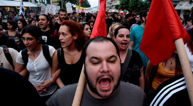 Demonstrators shout slogans during a rally by supporters of the 'No' vote to the upcoming referendum in the northern Greek port city of Thessaloniki, Wednesday, July 1, 2015