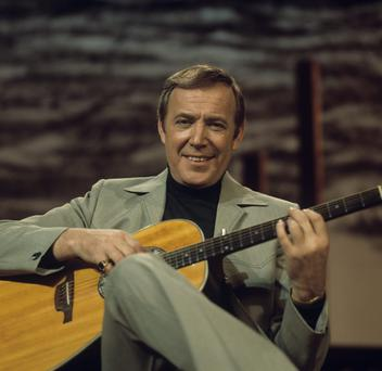 UNITED KINGDOM - JANUARY 01: Irish singer Val Doonican performs on a television show circa 1970. (Photo by David Redfern/Redferns)