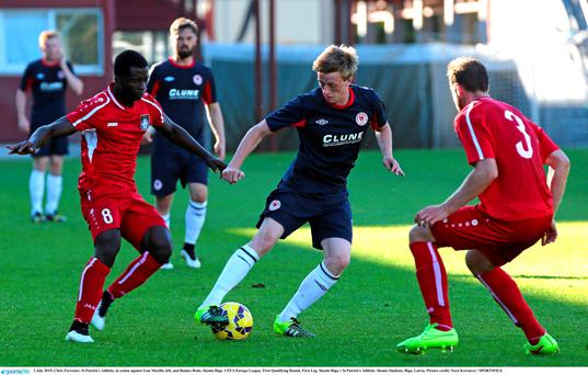 Chris Forrester, St Patrick's Athletic, in action against Ivan Murillo, left, and Reners Rode, Skonto Riga.