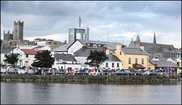 Crowds gather at Flynn's Funeral Home on The Strand along the banks of the Shannon for Larry and Martina Hayes tragically killed in Tunisia who were reposing there. Pic Steve Humphreys 2nd July 2015.