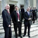 Taoiseach Bertie Ahern, Foreign Minister Brian Cowen, and Finance Minister Charlie McCreevy share a joke before a Cabinet meeting at Emo Court in Co Laois in 2003. Photo: Frank McGrath