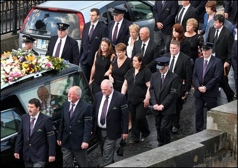 The remains of Larry and Martina Hayes tragically killed in Tunisia cross the Shannon to arrive at the Church of St Peter and Paul where the funeral mass will take. Pic Steve Humphreys 2nd July 2015.